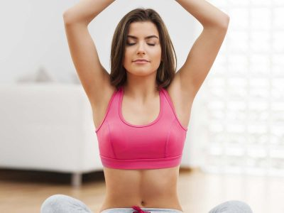 focus-woman-doing-yoga-at-home-XEQ2PR8.jpg